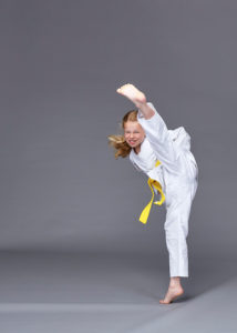 ninja kick in a portrait studio