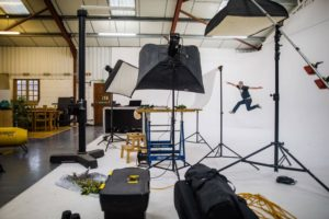 photo studio hire client jumps for joy