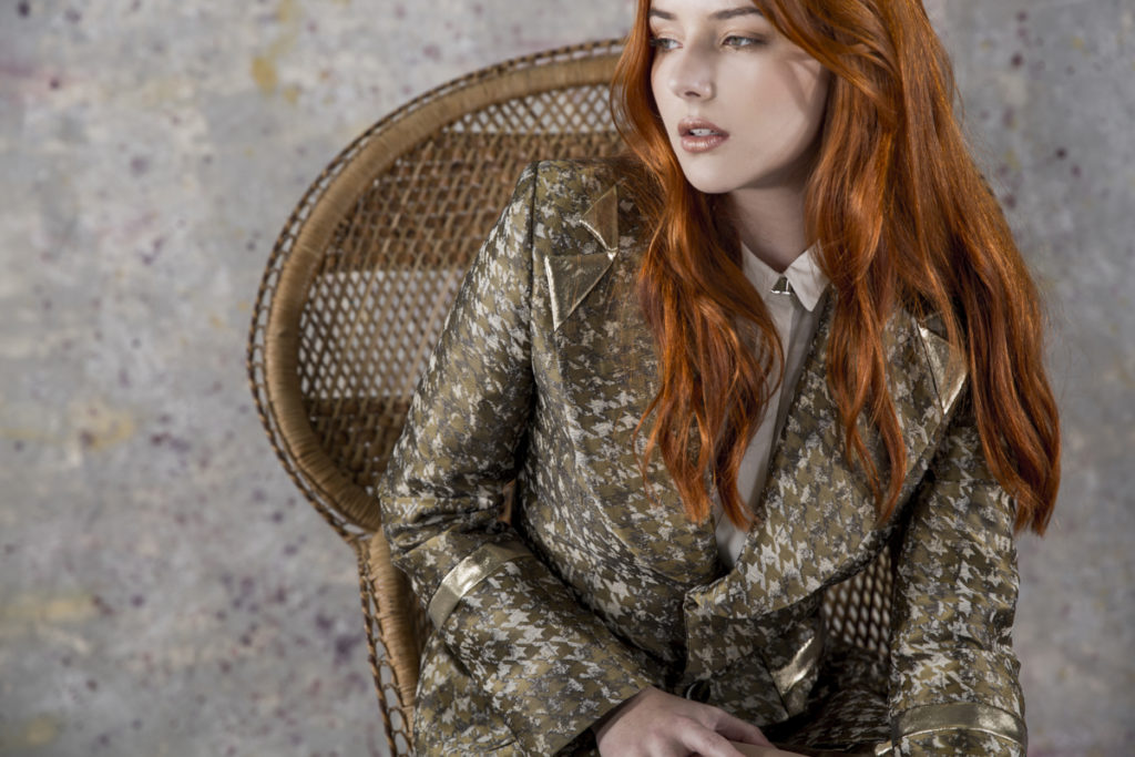 studio photo of red haired model in chair
