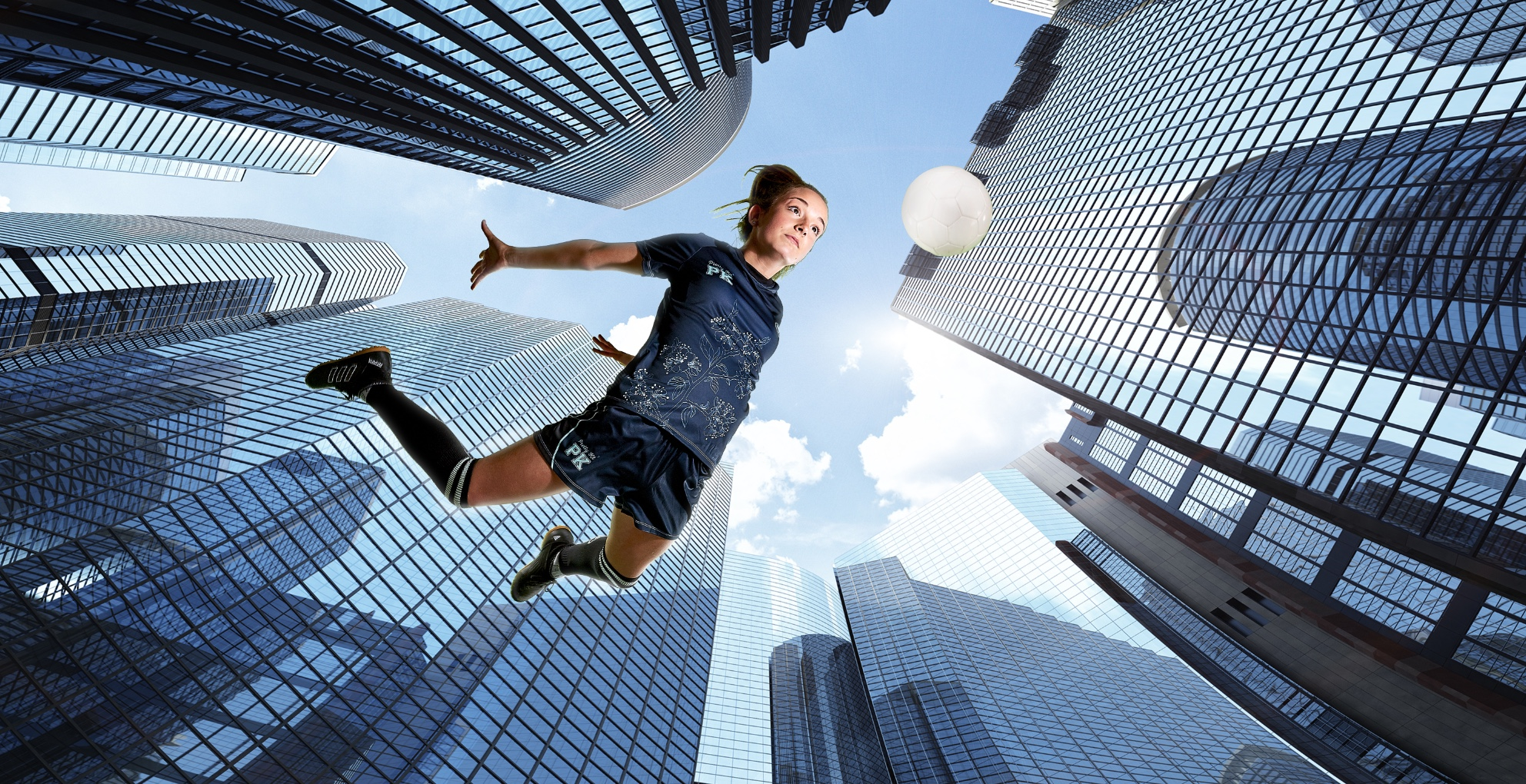 photo studio shot of girl footballer flying across cityscape